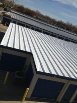 SureCoat roof coating over a flat metal roof